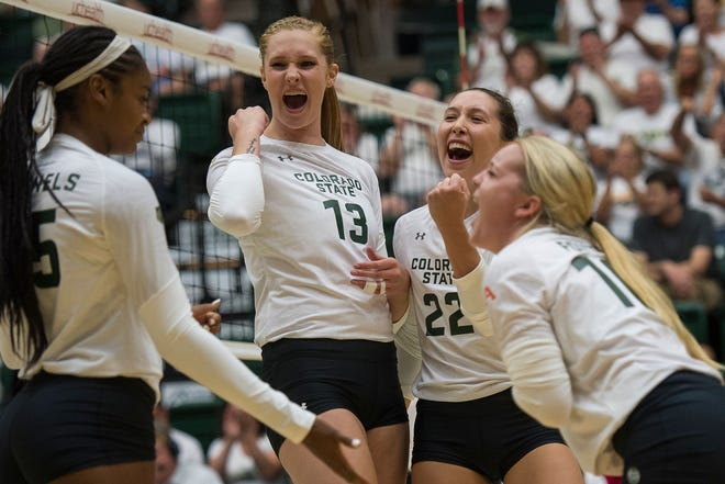 CSU volleyball players celebrate a point during a five-set loss Friday night to No. 12 Illinois at Moby Arena. The 25th-ranked Rams will play matches Tuesday night at Northern Colorado and at home both Saturday and Sunday this week.