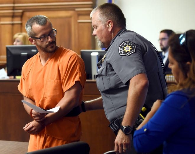 Christopher Watts glances back at a Weld County Sheriff's Deputy as he is escorted out of the courtroom at the Weld County Courthouse Thursday, Aug. 16, 2018, in Greeley, Colo. Watts, of Colorado, whose wife and daughters disappeared this week was arrested on suspicion of killing them.