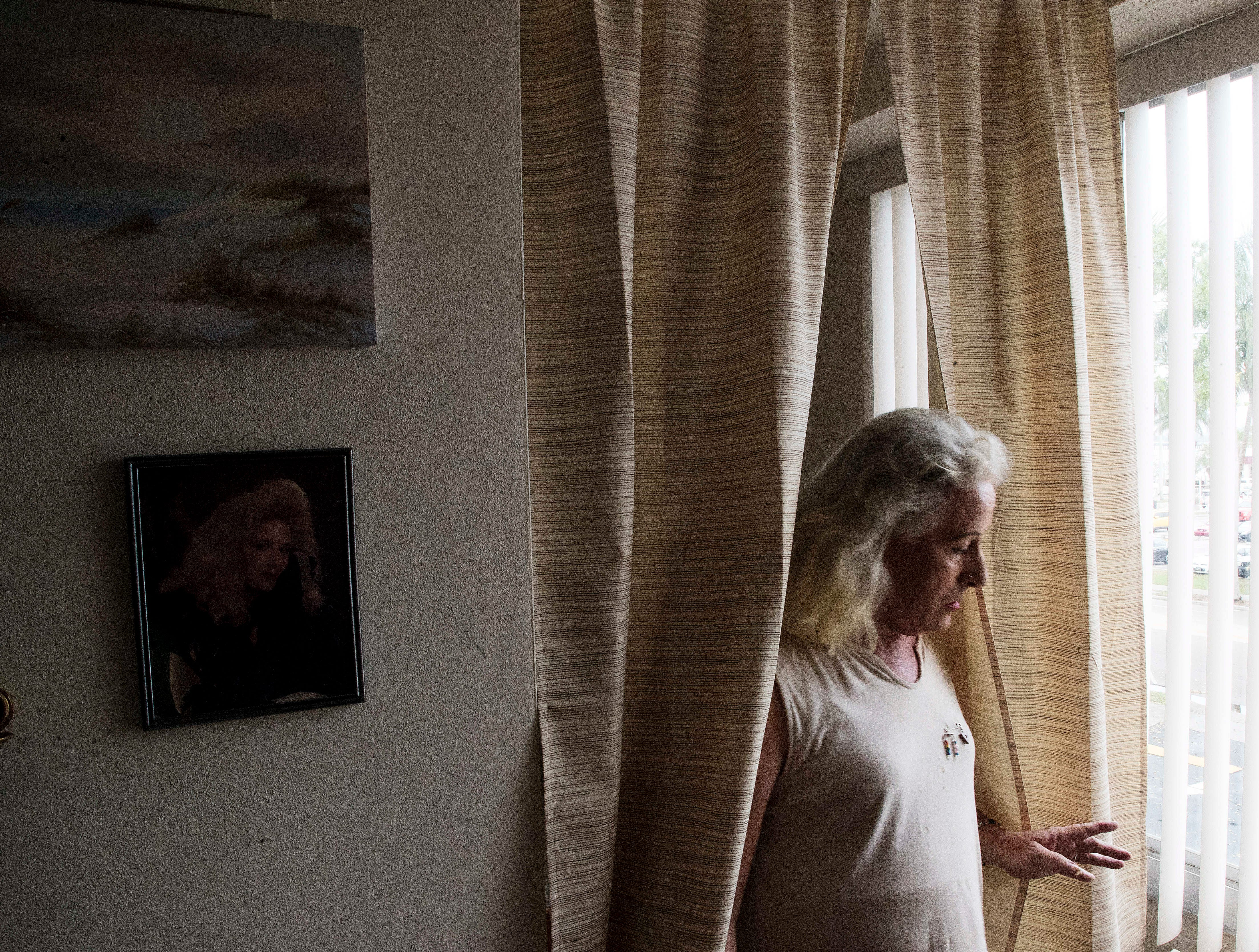 Jenna Satterfield is seen her downtown Fort Myers apartment complex. Satterfield, 62, has always identified as a woman but because of stigma and the fear of violence, waited to come out until the 1990's.