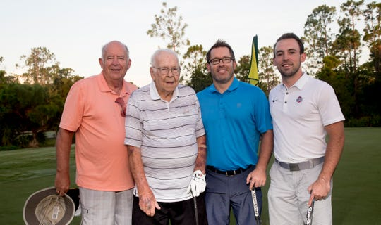 Lewis Keister,92, second from left,  of Fort Myers plays a round of golf with his son, Steve Keister, grandson, J.D. Keister and great grandson, Alex Odenweller, at Old Corkscrew Golf Club on Thursday morning. Four generations played in the same foursome along with family in groups behind them.