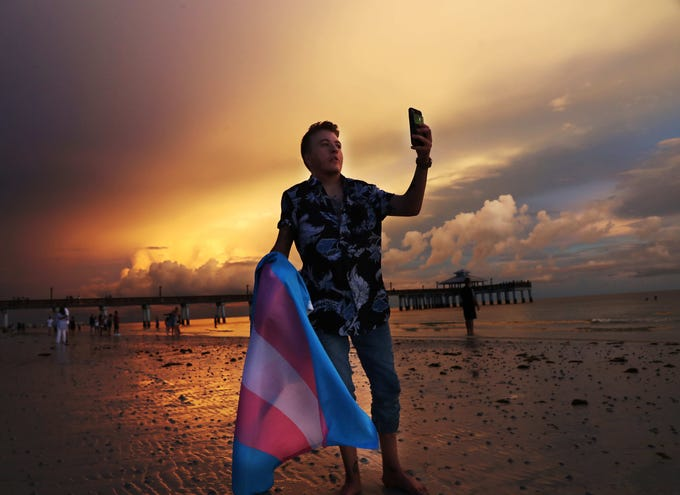 Kasey Fraize, 20, enjoys a recent sunset on Fort Myers Beach. Fraize, a transgender man from New Port Richey always identified with masculine things but waited until he started college at FGCU to start hormone replacement therapy.