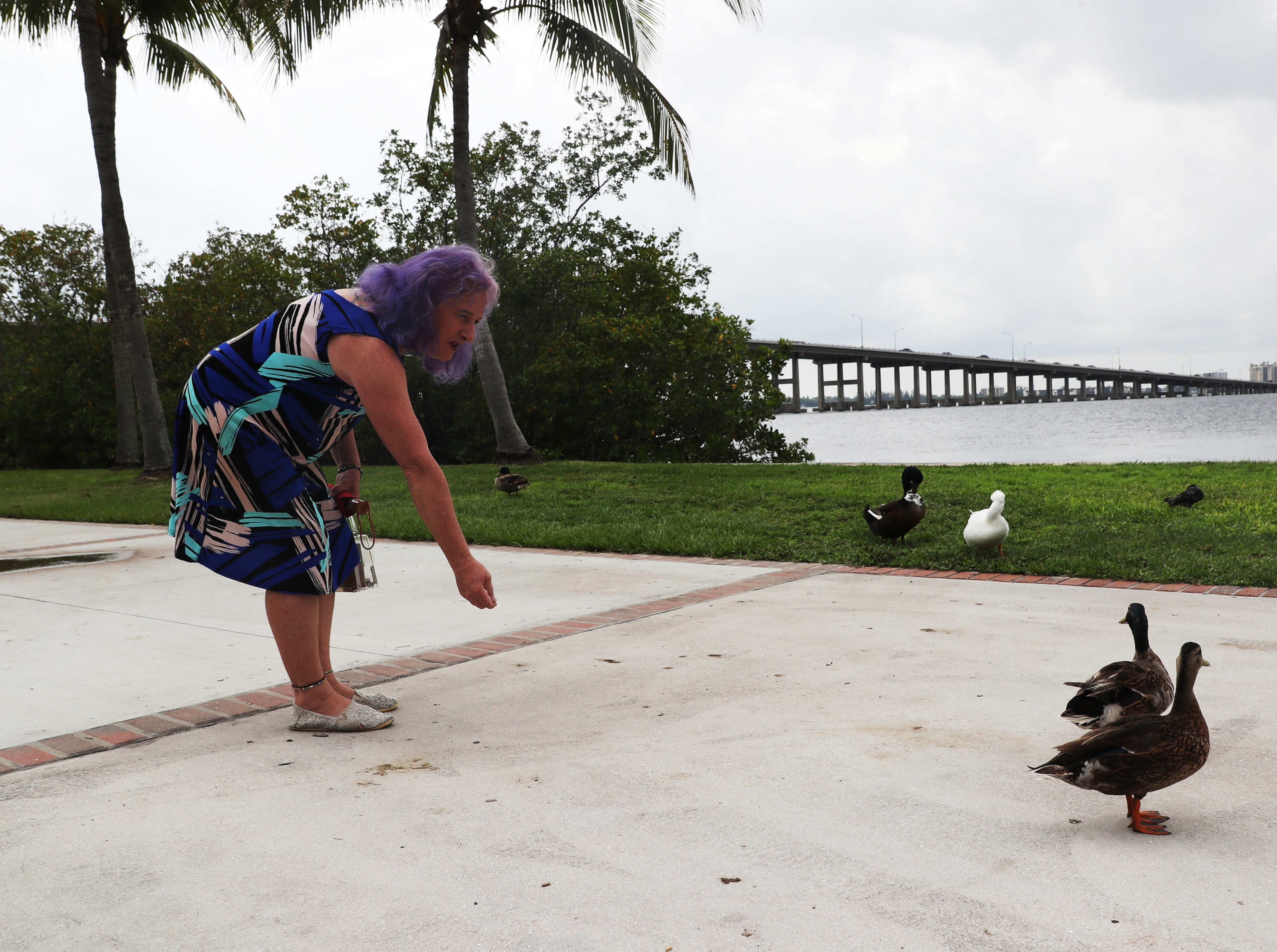 Jenna Satterfield feeds the ducks on the downtown Fort Myers river front. A child of 1960's from New Jersey who always identified with female things Satterfield says transgender women of her generation could be beaten or killed. For this reason she waited until the 1990's to come out.