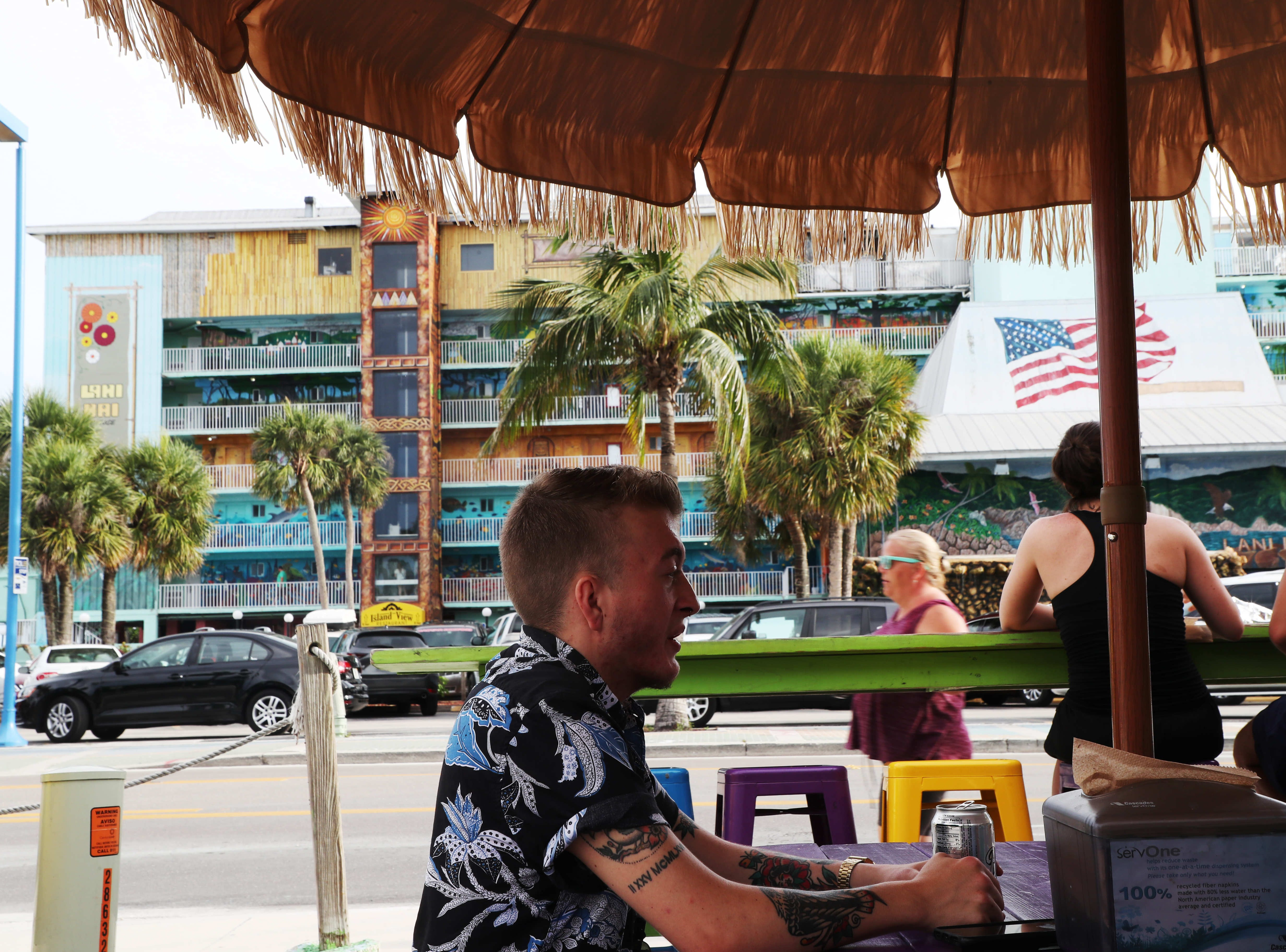 Kasey Fraize takes in a meal recently on Fort Myers Beach. Fraize struggled through middle and high school with his female identity, at 15 he knew he wanted to transition but waited until college to avoid the hassles of parents, teachers and peers.