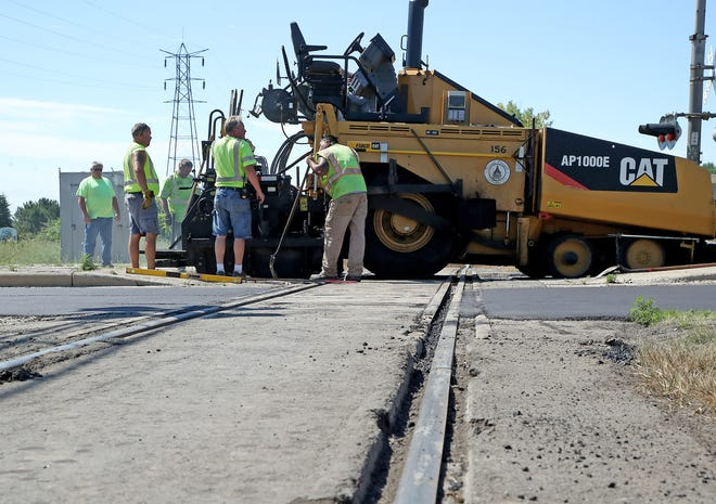 Brown County road crews were busy July 16 repairing and repaving the railroad crossing on Lineville Road just west of Velp Avenue in Howard.