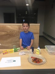 This student created fake vomit as part of a prank kit he intends to sell during the Children's Business Fair on Aug. 22 at Gather on Broadway.