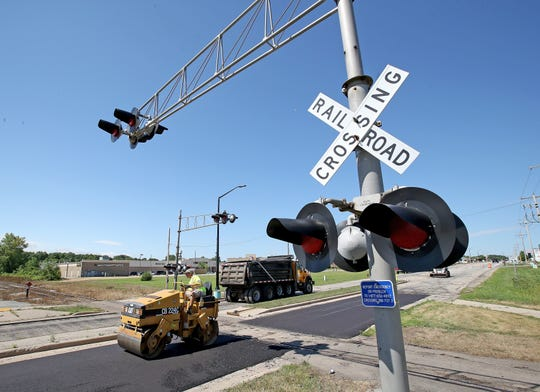 Brown County road crews on July 16 repair and repave the railroad crossing on Lineville Road just west of Velp Avenue in Howard.