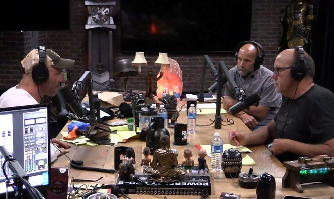Joe Rogan, left, interviews Bryan Richards, center, and Doug Duren on the 'Joe Rogan Experience' podcast Aug. 8 in Los Angeles.