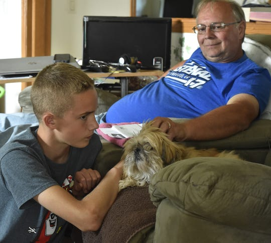 Dale Cihlar's 13-year-old grandson David Baxter has been helping on the family dairy farm in Clay Banks since Dale injured a foot. The Cihlars struggle to stay in business due to low milk prices. The Cihlars have gained some financial stability through a GoFundMe page on the internet.