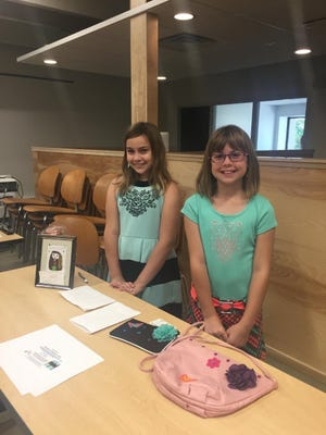 Two students will be selling up-cycled purses and accessories during the Children's Business Fair at Gather on Broadway on Aug. 22.
