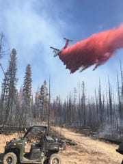 Firefighters continue suppression work on the Trail 467 Fire southeast of Lincoln.