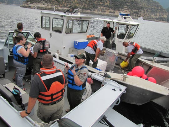 Recovery teams coordinate during the search for two men missing after a boating accident in the Bighorn Canyon.