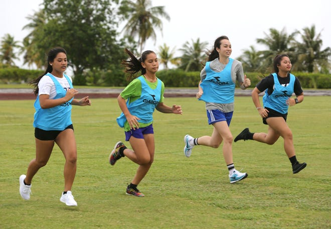 Participants in the 2018 Guam Football Association referee camp participate in a referee fitness test at LeoPalace Resort Guam.