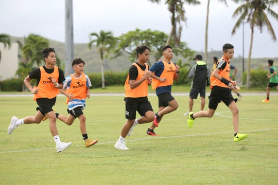 Participants in the 2018 Guam Football Association Referee Camp run as part of a fitness test at LeoPalace Resort Guam.