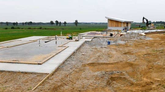 Three bed-and-breakfast cabins under construction on the Farmer & Frenchman property. The establishment's future may depend on the outcome of a referendum on the legality of a small farm winery in the Anthoston precinct, with the voting being held, on August 28th, Wednesday, August 15, 2018.