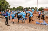 An army of volunteers built a playground an garden at Carriage House East apartments on Thursday, Aug. 16, 2018.