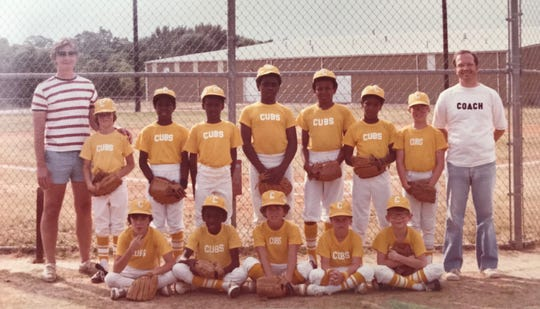 """The integrated 1980 Oxford Park Commission Cubs. Gregg Doyel's father is in the """"coach"""" shirt; Gregg is next to him. The segregated team folded after this year."""