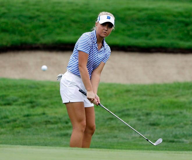 Erica Shepherd chips to the 13th green during the first round of the Indy Women in Tech Championship golf tournament, Thursday.