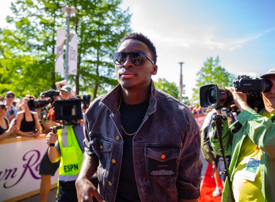 May 27, 2018; Indianapolis, IN, USA; Indiana Pacers guard Victor Oladipo walks the IndyCar Series red carpet prior to the 102nd Running of the Indianapolis 500 at Indianapolis Motor Speedway. Mandatory Credit: Mark J. Rebilas-USA TODAY Sports