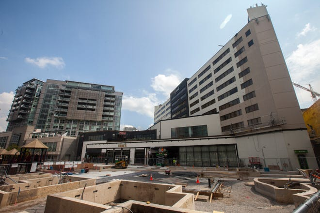 Construction continues along College and Washington Streets in front of the Graduate Hotel (right) on Thursday, Aug. 16, 2018, in the Pedestrian Mall in Iowa City.