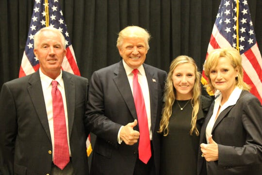 Appointed U.S. Sen. Cindy Hyde-Smith, right, and her family with President Donald Trump.