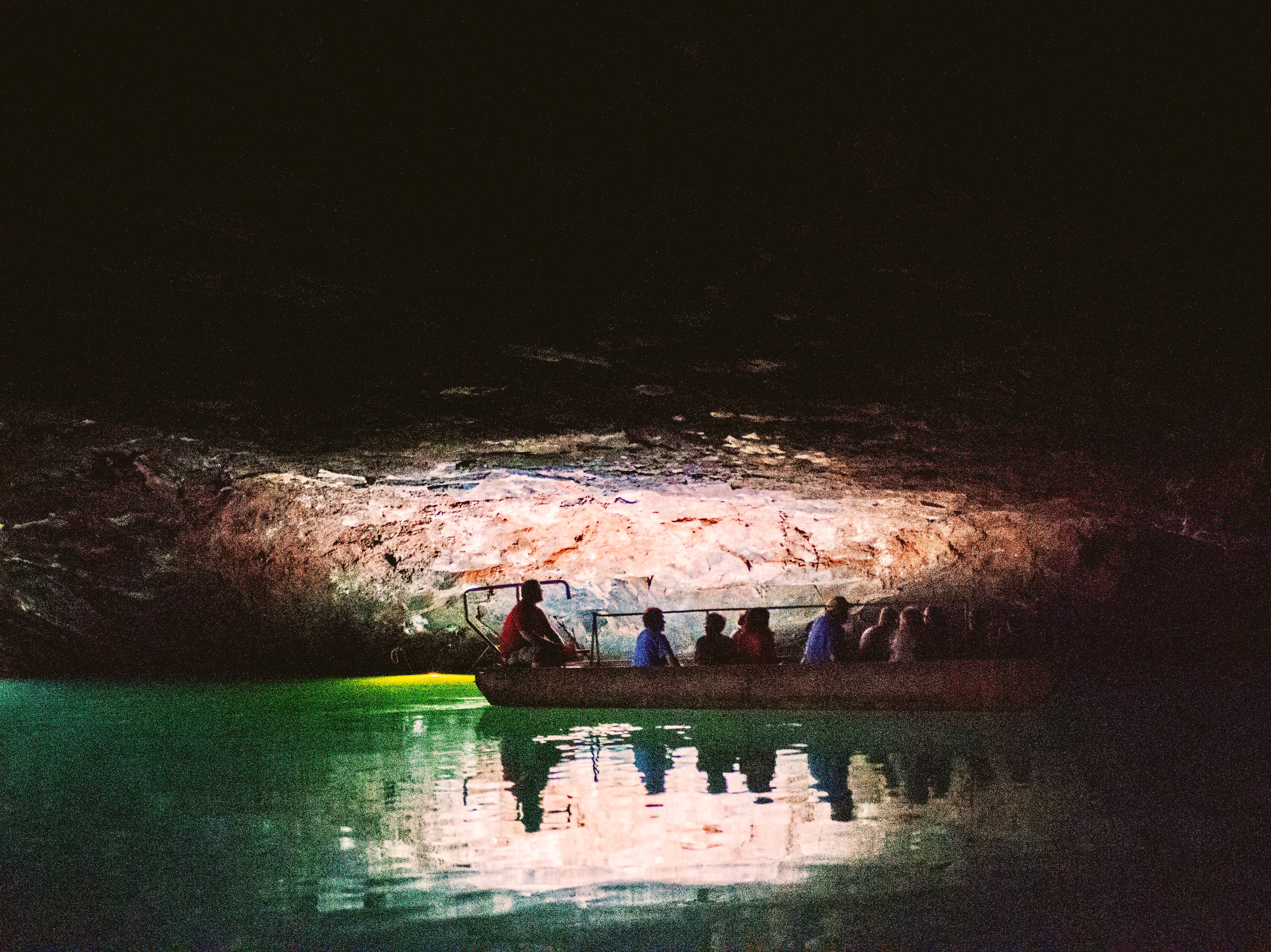 Tour guide Cody Isbill takes visitors for a ride through an underground lake at the Lost Sea Adventure cave attraction outside of Sweetwater, Tennessee on Wednesday, August 15, 2018. The cave system dates back some 20,000 years and today features points of interests like an old moonshine still, rock formations, Confederate Army graffiti and the popular boat ride in a natural lake stocked with 200 rainbow trout.
