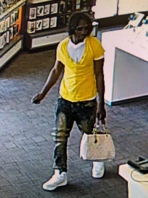 Pictured is a suspect wanted in a cell phone store robbery last week.