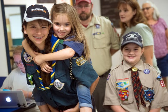 From left, sisters Alyssa Ross, Makenzee Ross, and Cassidy Ross are all involved in programs with the Boy Scouts of America. Alyssa is with the Venturing Crew, Makenzee is a Tiger Scout, and Cassidy is a Cub Scout.