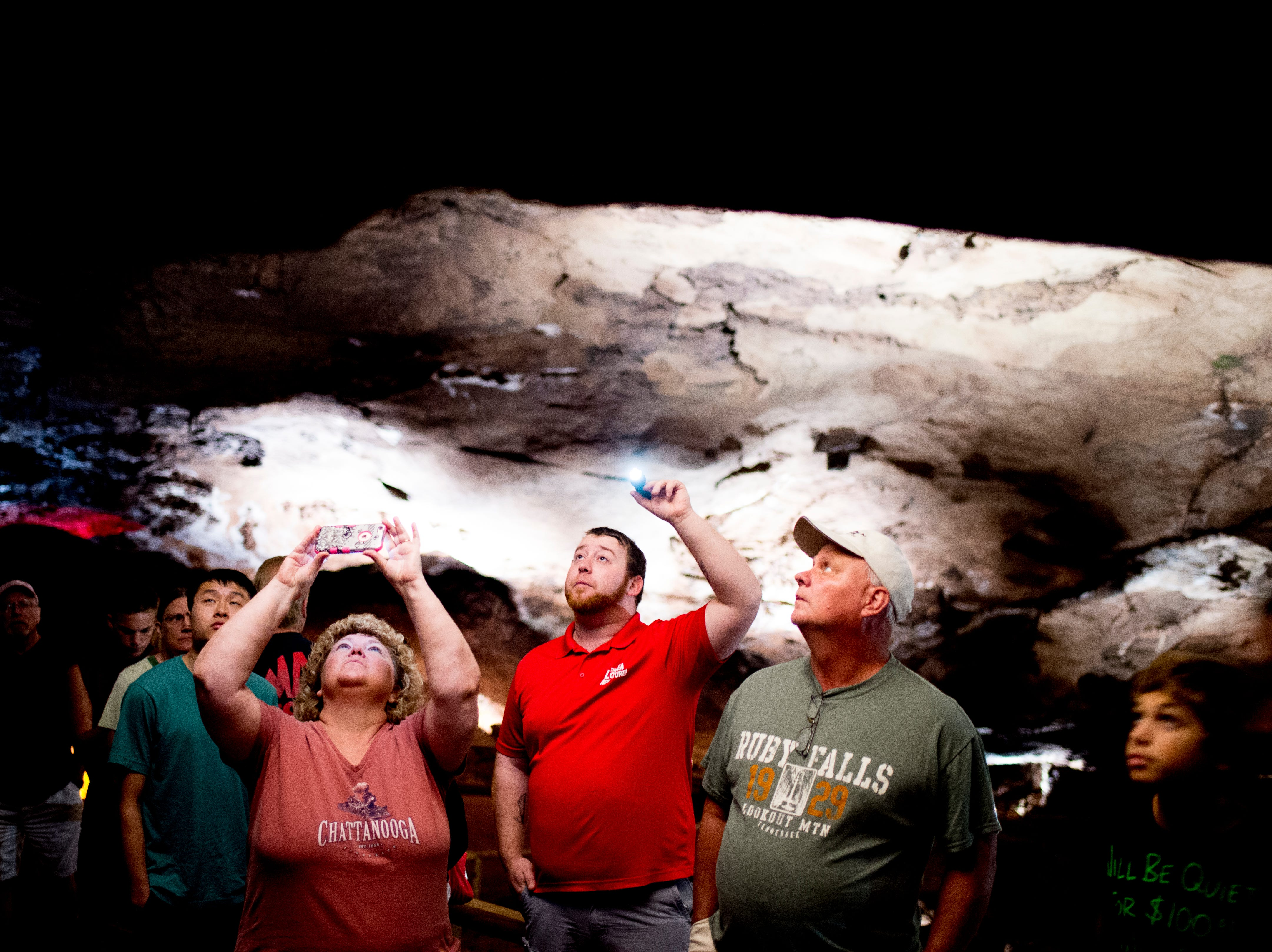 Tour guide Cody Isbill points out Òanthodites,Ó fragile, spiky clusters commonly known as Òcave flowersÓ only found in few caves around the world at the Lost Sea Adventure underground cave attraction outside of Sweetwater, Tennessee on Wednesday, August 15, 2018. The cave system dates back some 20,000 years and today features points of interests like an old moonshine still, rock formations, Confederate Army graffiti and the popular boat ride in a natural lake stocked with 200 rainbow trout.