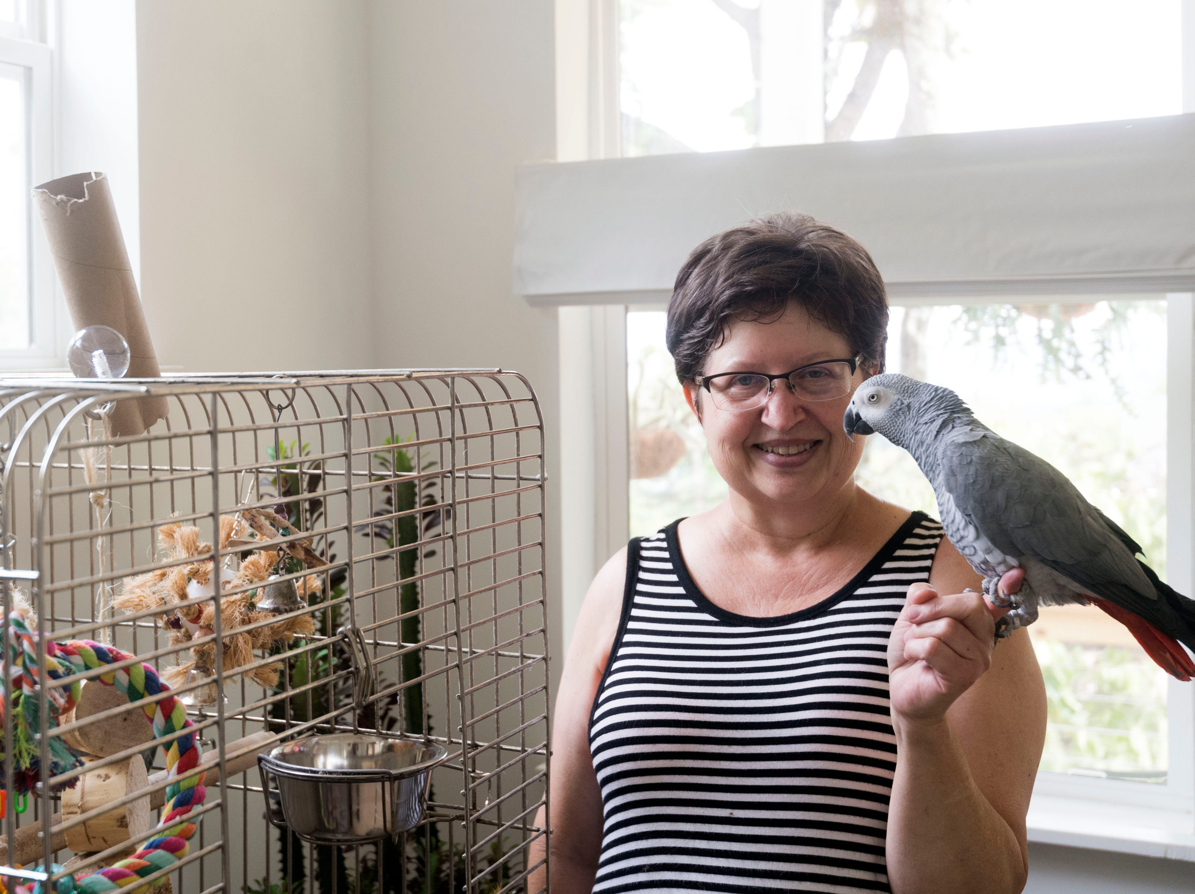 Margeaux Emery, an African grey parrot named Simon, and four cats are the first resident at Richmond Orchard, a tiny house community in Knoxville.