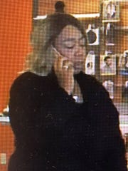 Pictured is a woman wanted in a cell phone store robbery on Clinton Highway last week.