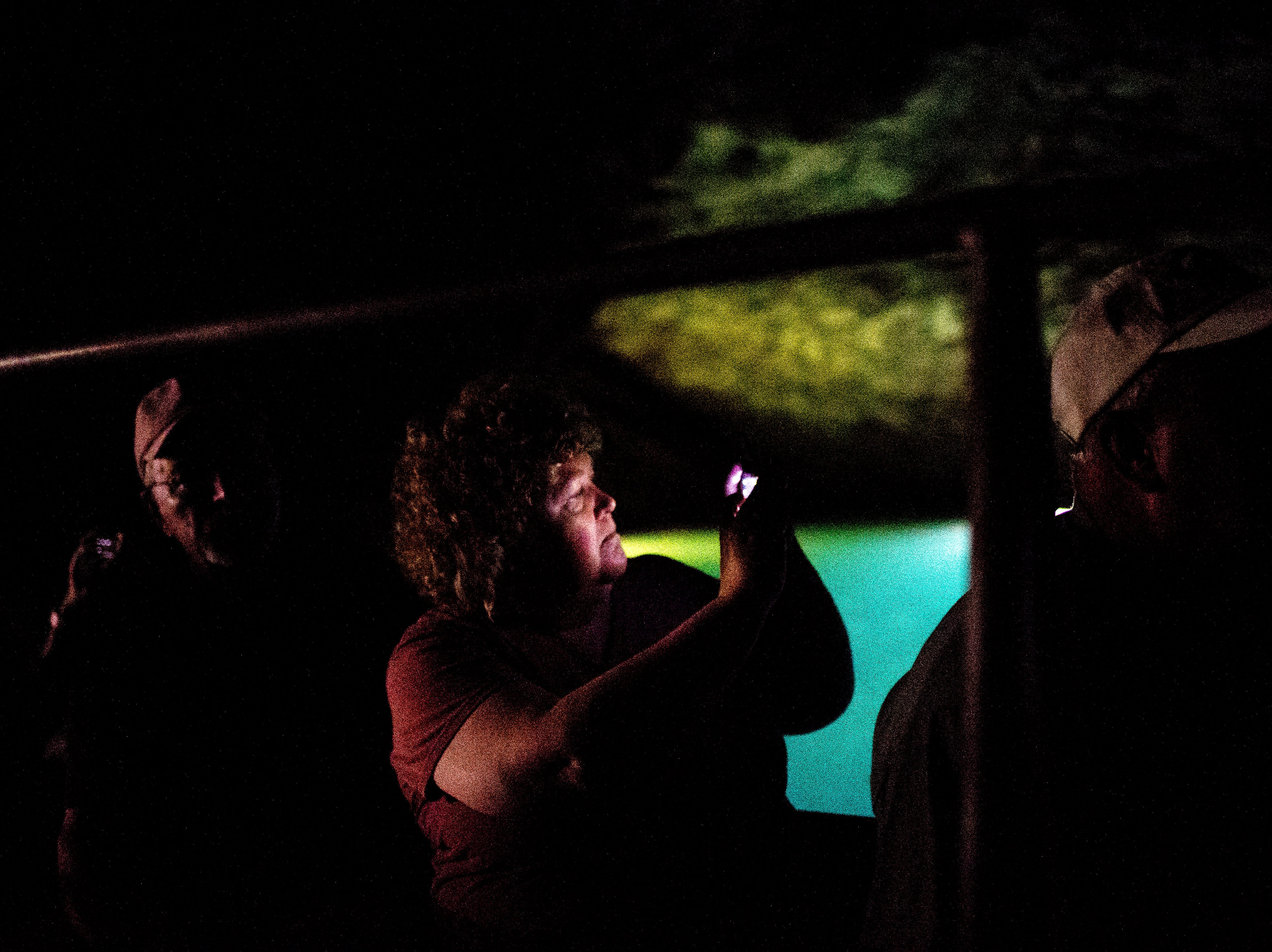A visitor snaps a photo on their phone at the Lost Sea Adventure underground cave attraction outside of Sweetwater, Tennessee on Wednesday, August 15, 2018. The cave system dates back some 20,000 years and today features points of interests like an old moonshine still, rock formations, Confederate Army graffiti and the popular boat ride in a natural lake stocked with 200 rainbow trout.