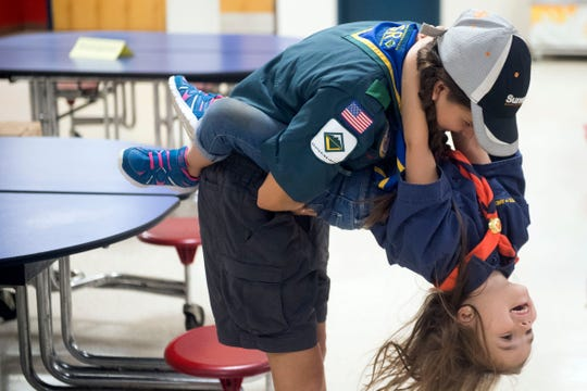 Alyssa Ross plays with her sister Makenzee during a Cub Scout recruitment drive at Halls Elementary School on Wednesday, August 15, 2018. Alyssa is a member of the Boy Scouts' Venturing Crew and Makenzee is a Tiger Scout.