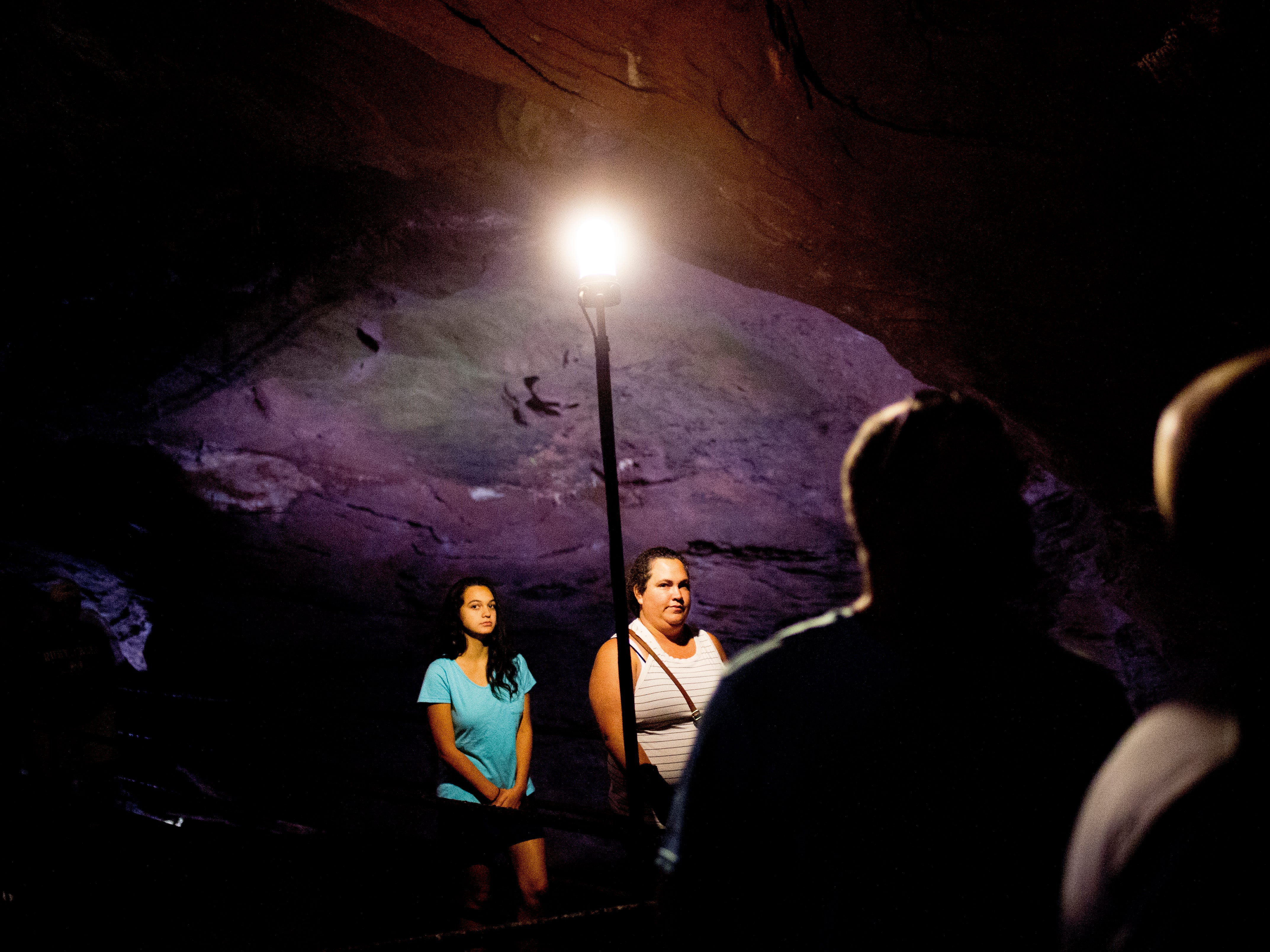 Visitors walk through the caves at the Lost Sea Adventure underground cave attraction outside of Sweetwater, Tennessee on Wednesday, August 15, 2018. The cave system dates back some 20,000 years and today features points of interests like an old moonshine still, rock formations, Confederate Army graffiti and the popular boat ride in a natural lake stocked with 200 rainbow trout.