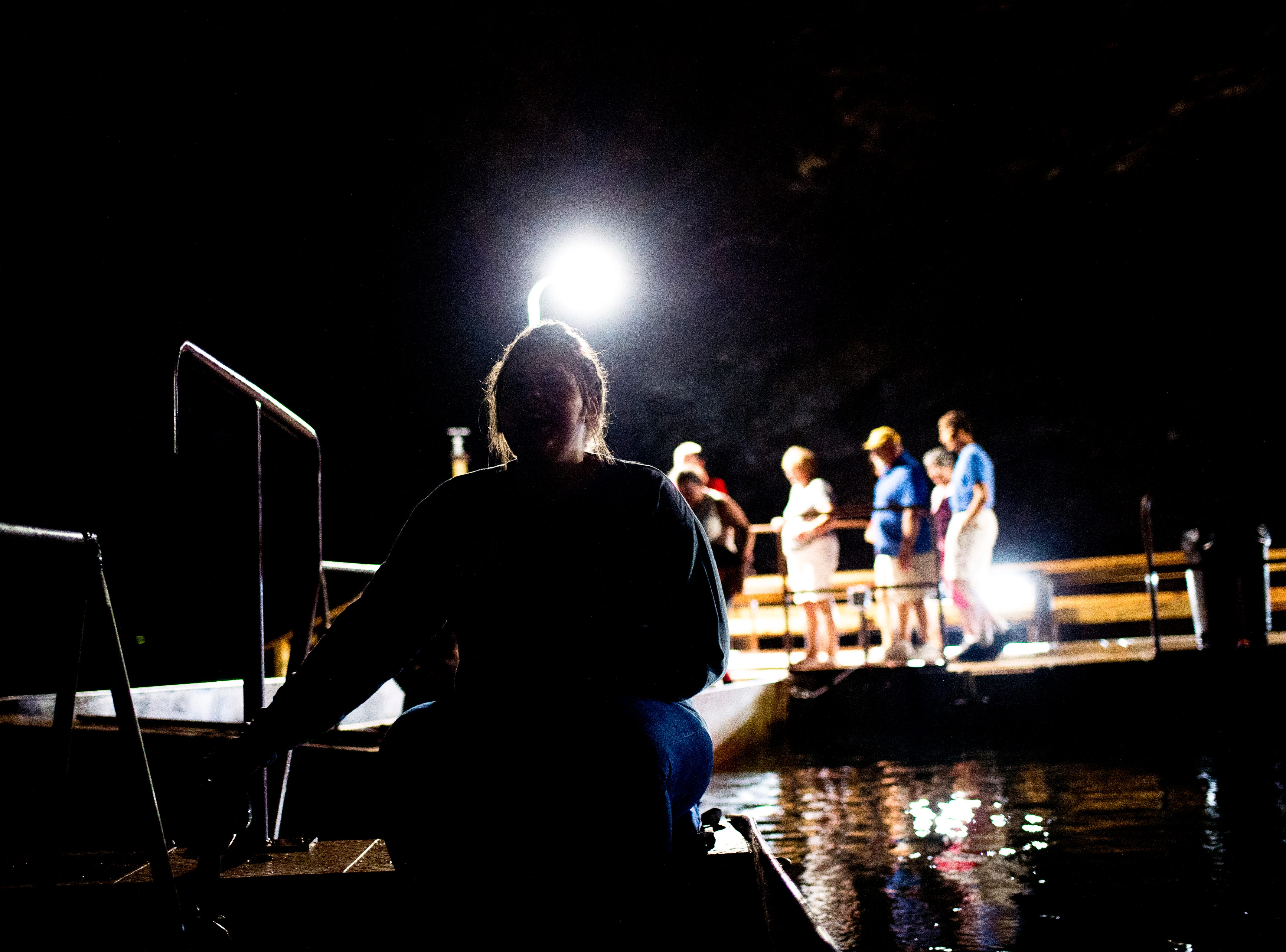 A tour guide leads the boat ride at the Lost Sea Adventure underground cave attraction outside of Sweetwater, Tennessee on Wednesday, August 15, 2018. The cave system dates back some 20,000 years and today features points of interests like an old moonshine still, rock formations, Confederate Army graffiti and the popular boat ride in a natural lake stocked with 200 rainbow trout.