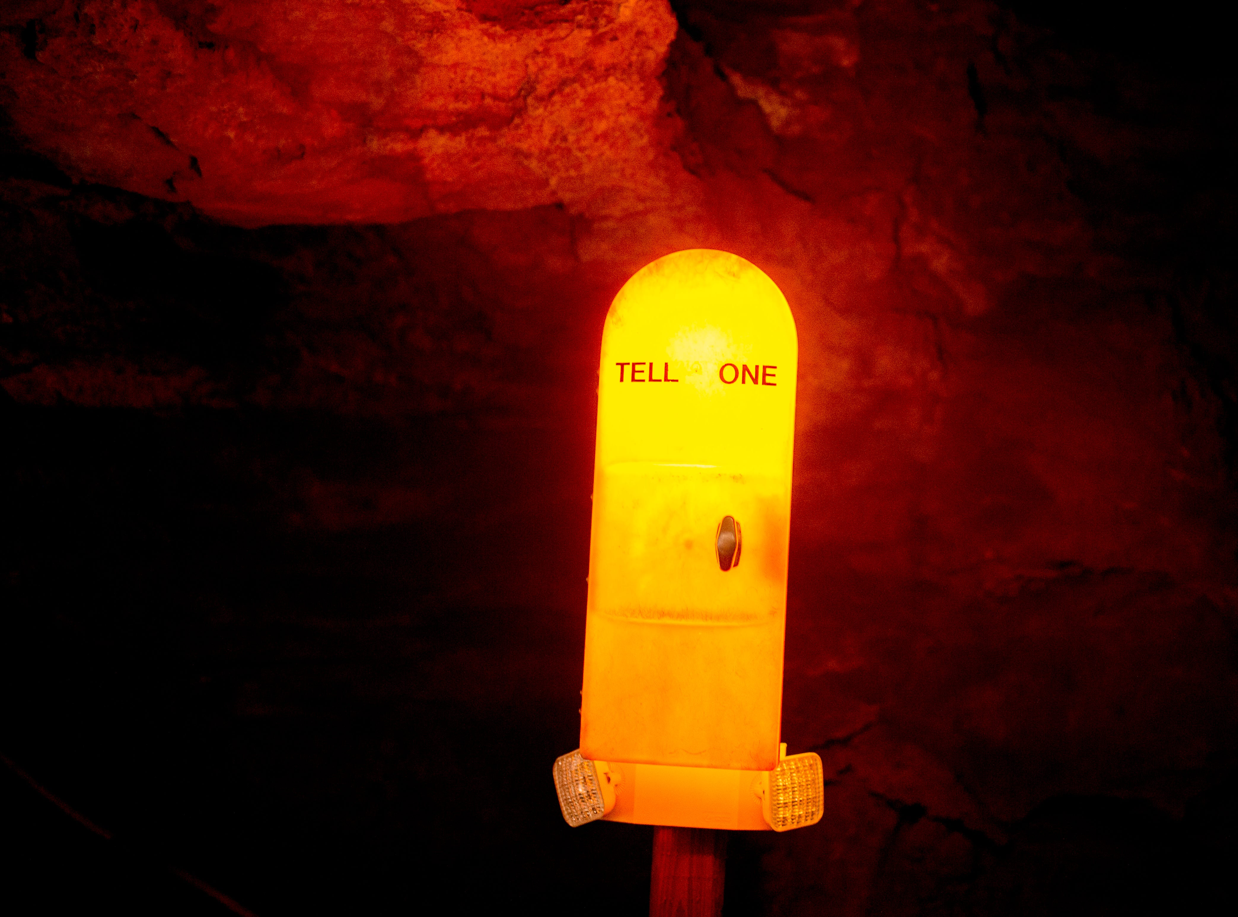 A telephone to the surface at the Lost Sea Adventure underground cave attraction outside of Sweetwater, Tennessee on Wednesday, August 15, 2018. The cave system dates back some 20,000 years and today features points of interests like an old moonshine still, rock formations, Confederate Army graffiti and the popular boat ride in a natural lake stocked with 200 rainbow trout.
