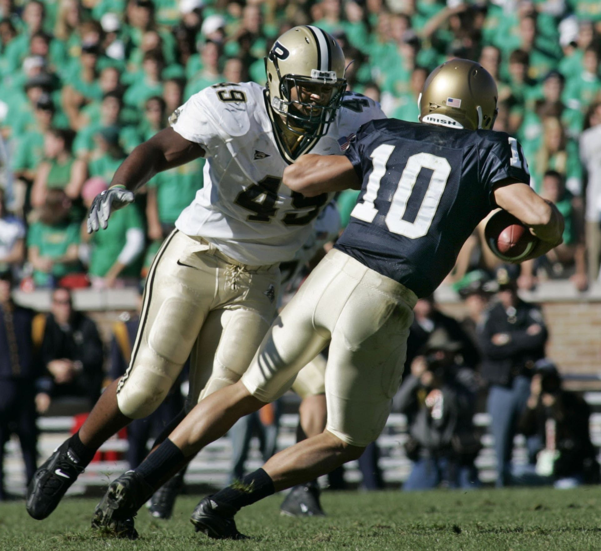 Anthony Spencer chases down Notre Dame quarterback Brady Quinn for a sack in the second quarter of Purdue's 41-16 victory in South Bend in 2004.
