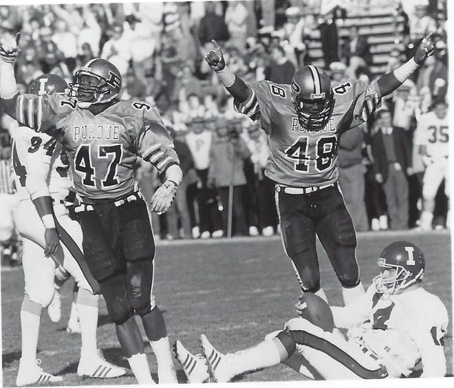 Purdue linebacker Fred Strickland (48) celebrates a sack against Indiana in 1986.