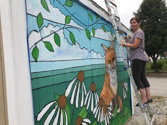 Bekki Canine, a Lafayette artist, is part of the Wabash Walls project in Lafayette's Wabash Avenue Neighborhood. Her mural is on the side of a Habitat for Humanity shed on Williams Street.
