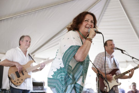 Charlene Howard performs with T.K. Hullin during the second day of Festivals Acadians et Creoles in Lafayette Oct. 15, 2016.