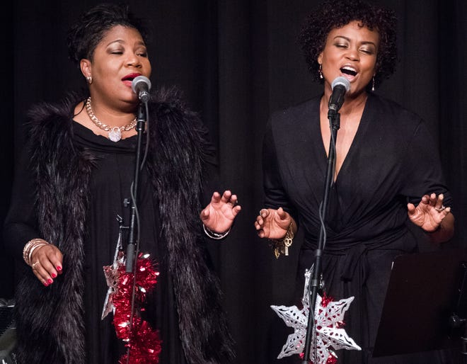 """Singers Melete Terry, left, and Alena Savoy sing with Steve Riley and the Mamou Playboys during Riley's 2017 Christmas show at the Liberty Theater in Eunice. Terry is among the local singers remembering the """"Queen of Soul"""" Aretha Franklin, who died Thursday."""
