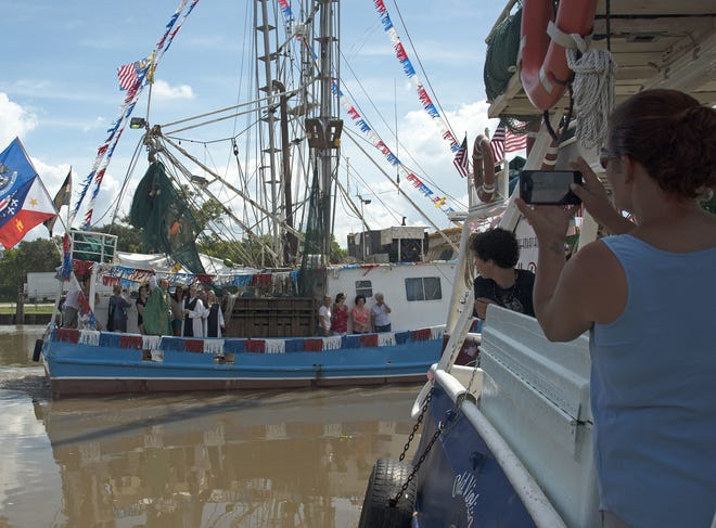 """Each year the festival holds the """"Blessing of the Fleet"""" for all shrimp fleets in Delcambre, La."""