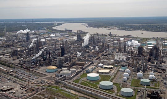 This March 8, 2018, photo, shows the Shell Norco oil refinery along the Mississippi River in Norco, La. The FBI is keenly aware of the dangers that cyber-criminals pose to Mississippi River-related businesses and south Louisiana infrastructure. And the agency wants the public at large to be aware, as well. (AP Photo/Gerald Herbert)