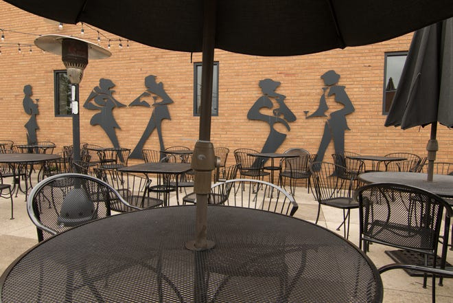 A new smokehouse BBQ restaurant is coming to downtown Brighton. Sheet metal silhouettes, designed by Michigan artist James Fox and shown Thursday, Aug. 16, 2018, were once a landmark of the Downtown Main Martini Bar & Grille, which closed in August 2018.