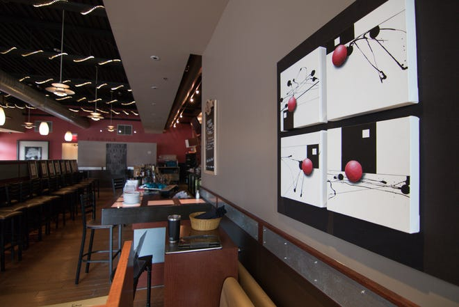 The artwork of Michigan artist James Fox, on exhibit in the now closed Downtown Main Martini Bar & Grille Thursday, Aug. 16, 2018, will be among the items auctioned off Aug. 25 and 26.