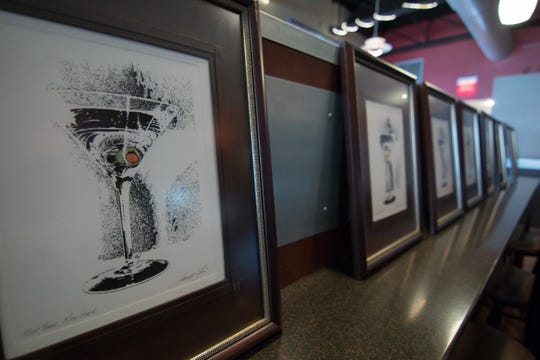Drawings done by artist James Fox, shown Thursday, Aug. 16, 2018, are among the items that will be auctioned off Aug. 25 and 26 as a result of the closing of Downtown Main Martini Bar & Grille.
