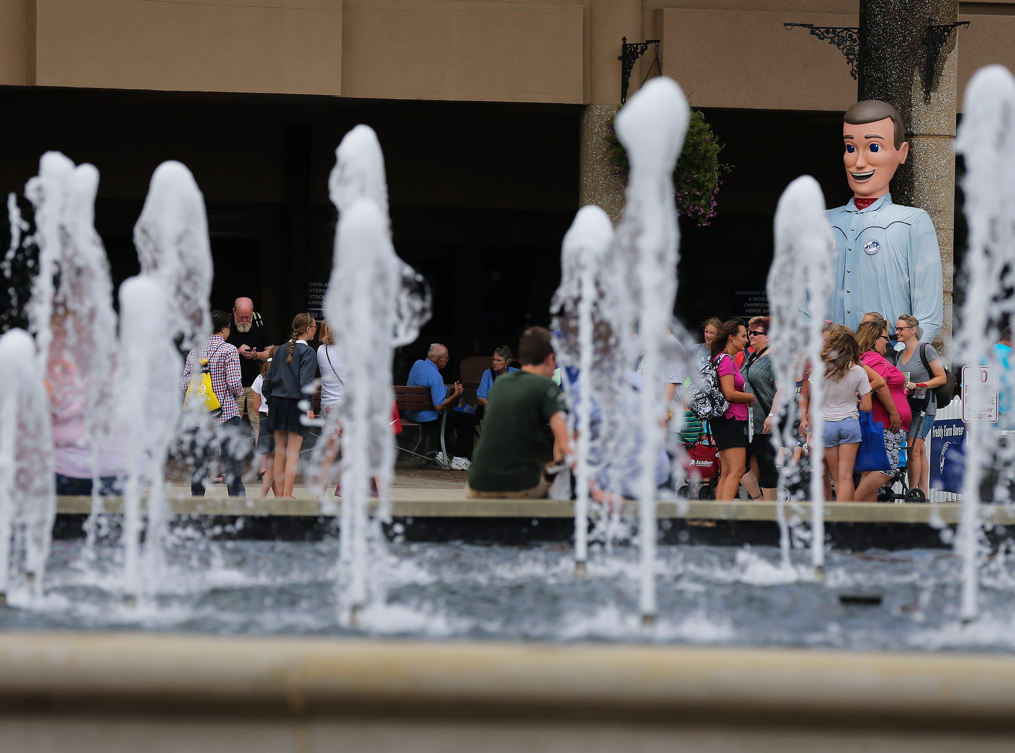 Freddie Farm Bureau peeks through water spray during the first day of the Kentucky State Fair.Aug. 16, 2018