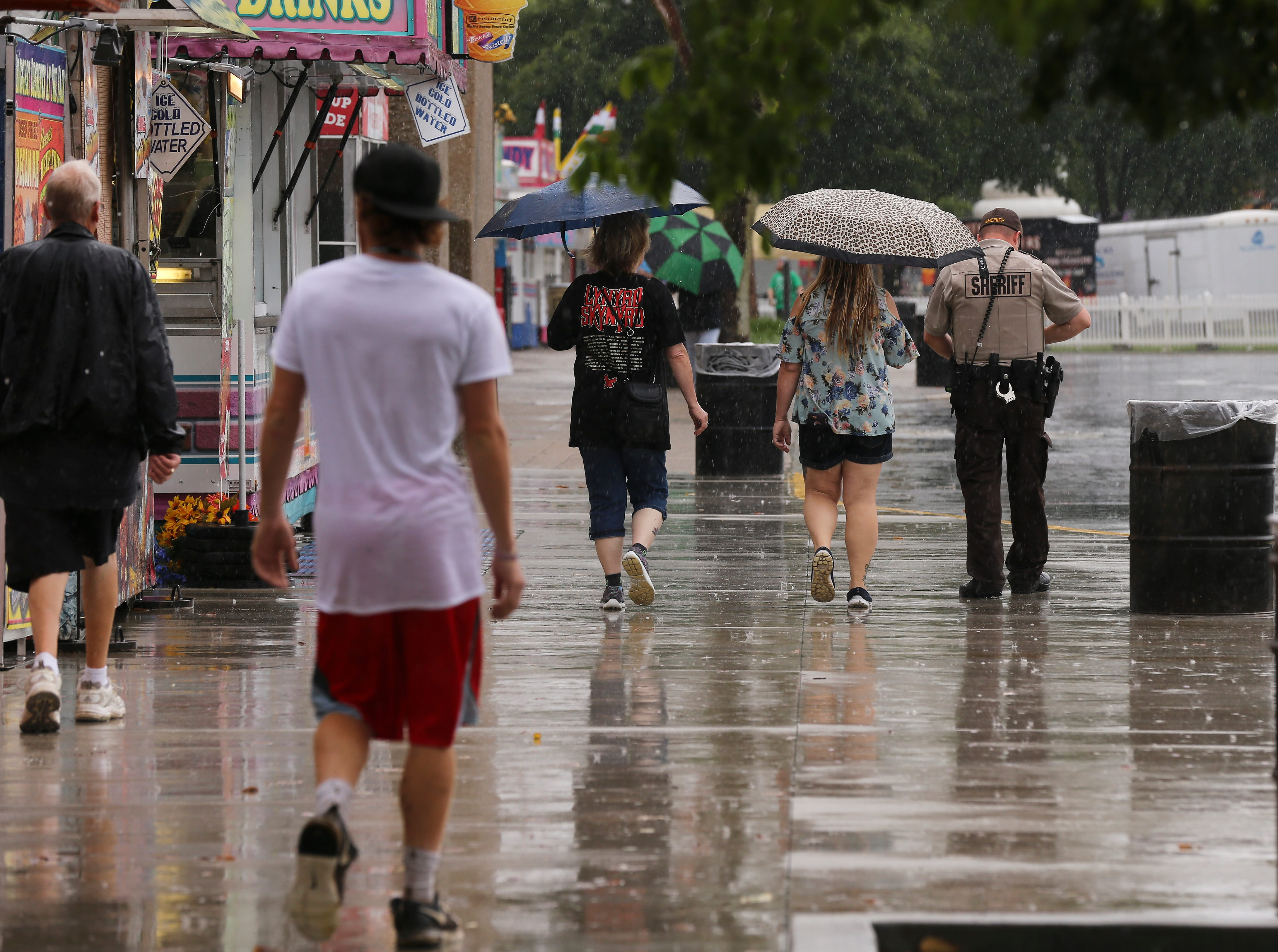 Fairgoers braved the rain on the first day of the Kentucky State Fair.Aug. 16, 2018