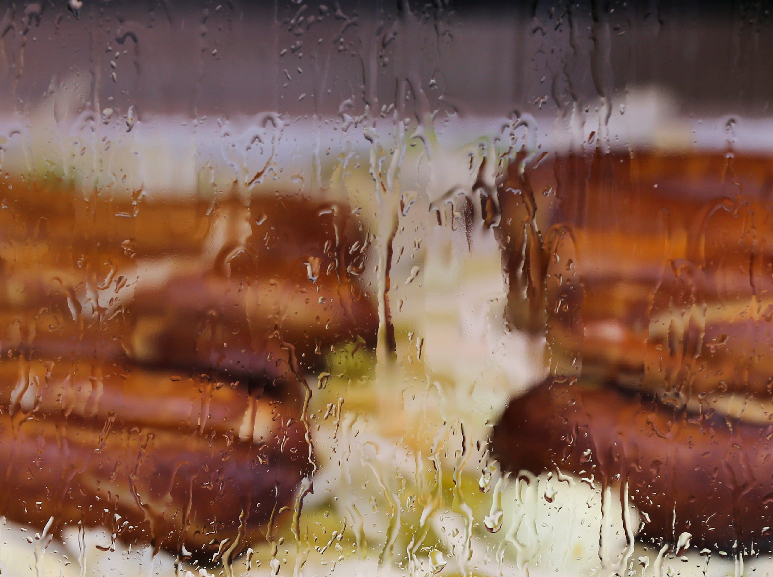 Bratwurst is obscured by rain streaming down a viewing panel on the first day of the Kentucky State Fair.Aug. 16, 2018