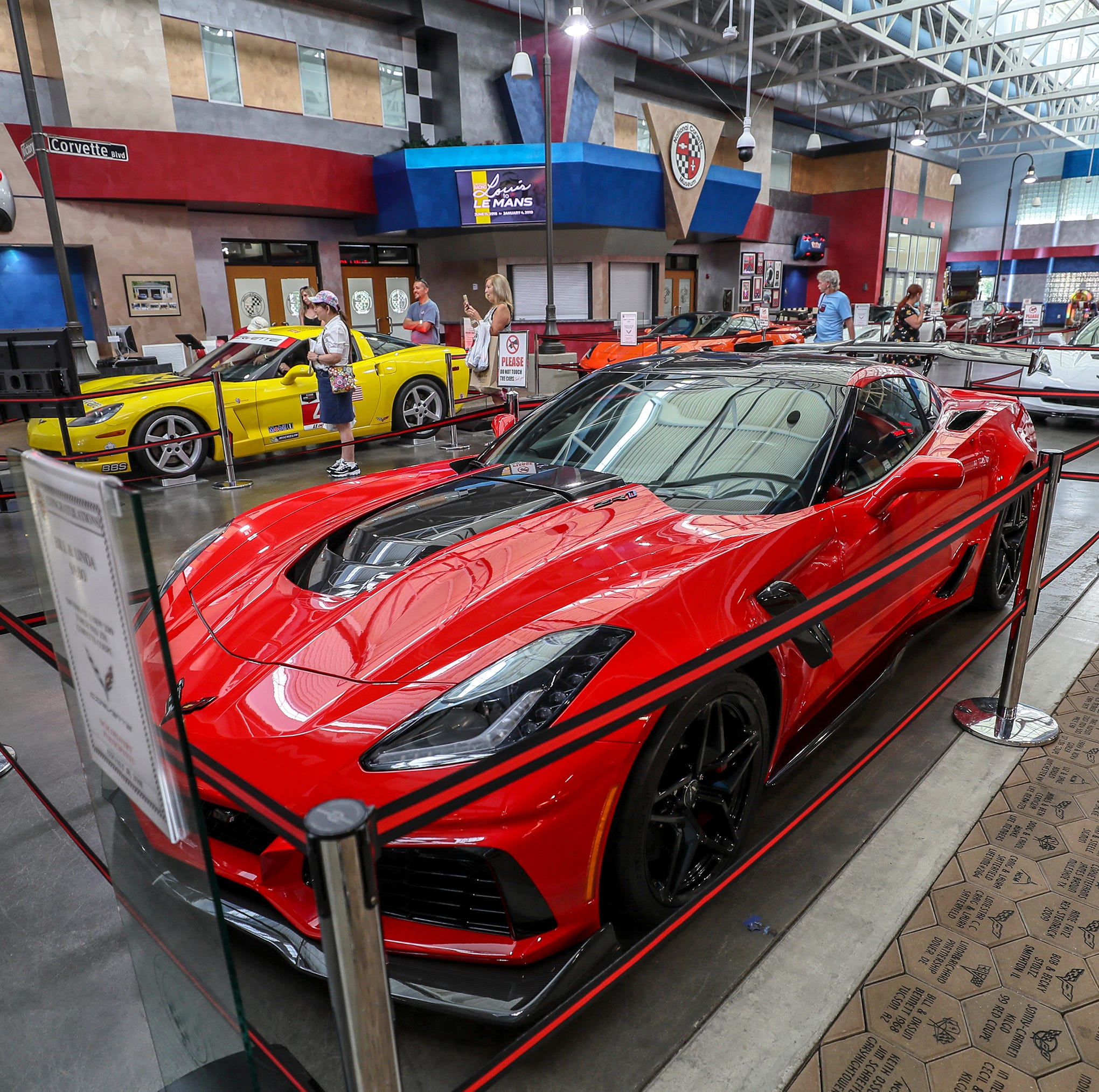 A shiny C7 Corvette on display at the National Corvette Museum in Bowling Green.