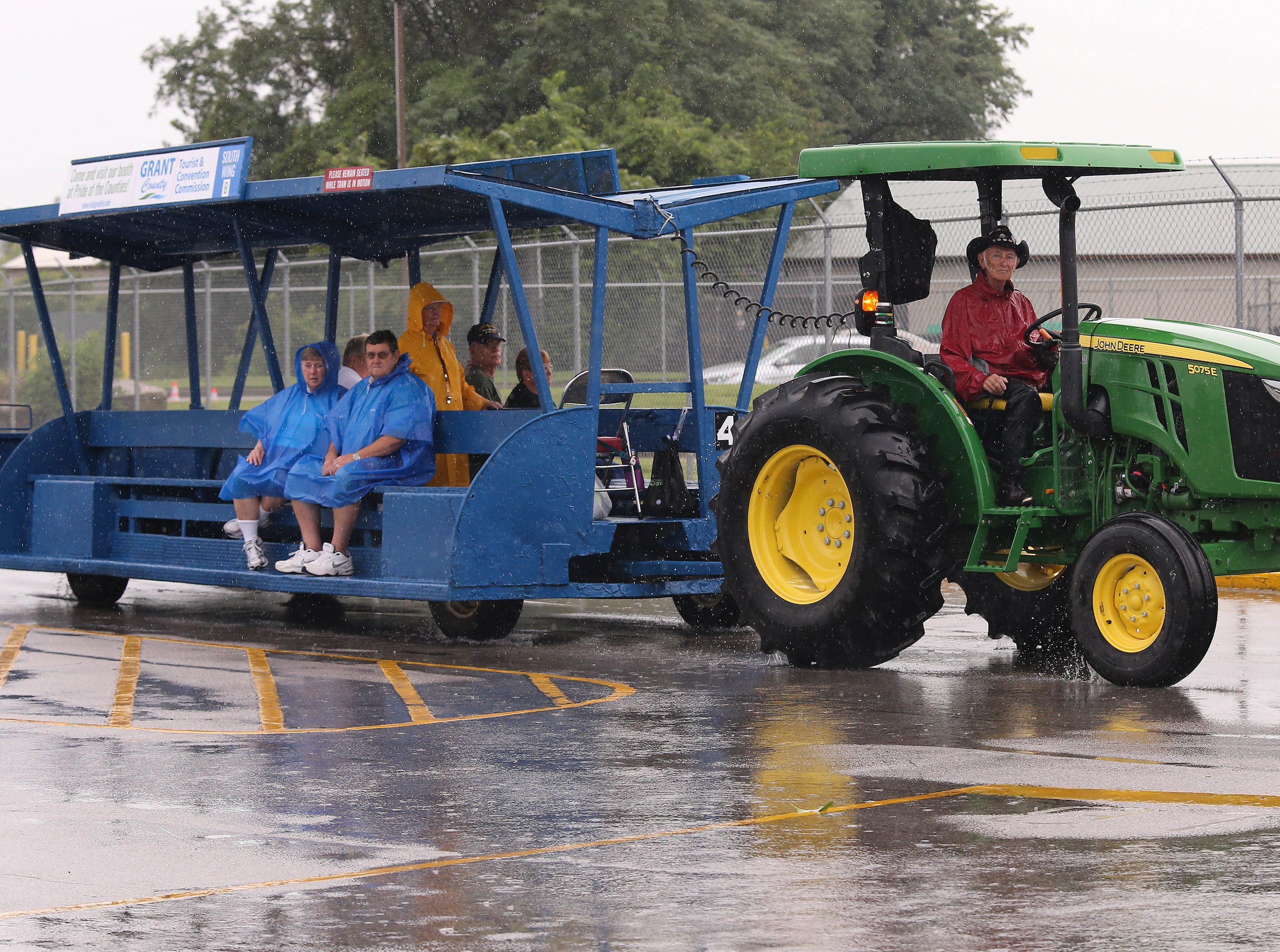 Fairgoers caught a ride to avoid the rain on the first day of the Kentucky State Fair.Aug. 16, 2018